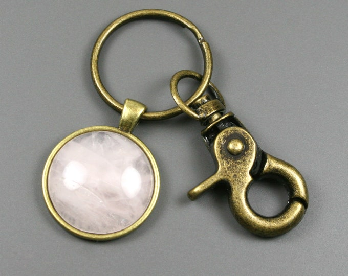 Rose quartz key chain in an antiqued brass setting with swivel lobster claw attachment