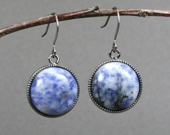 Blue and white spotted stone earrings in gunmetal plated bezels on gunmetal plated ear wires
