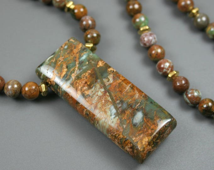 "Green ""opal"" pendant on a strand of green ""opal"" and antiqued gold plated spacer beads"
