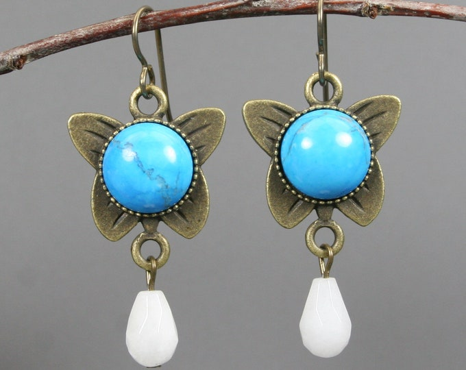 Turquoise howlite butterfly earrings with snow quartz teardrops on antiqued brass ear wires