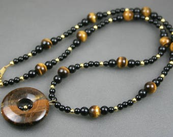 Tiger eye donut pendant on beaded strand of obsidian, tiger eye, and gold plated beads