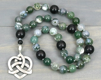Moss agate gratitude beads with black wood and an antiqued pewter Celtic heart knot opening focal on hand knotted cord