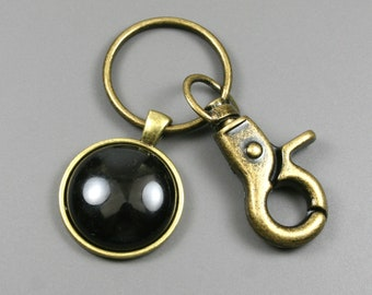 Black onyx key chain in an antiqued brass setting with swivel lobster claw