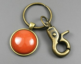 Red jasper key chain in an antiqued brass setting with swivel lobster claw