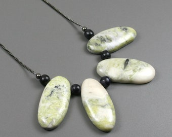 Green earth jasper fan necklace with black wood beads on gunmetal curb chain