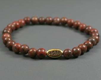 Red sesame jasper stacking stretch bracelet with antiqued gold plated pewter HOPE bead