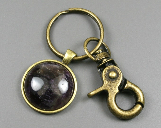 Amethyst key chain in an antiqued brass setting with swivel lobster claw
