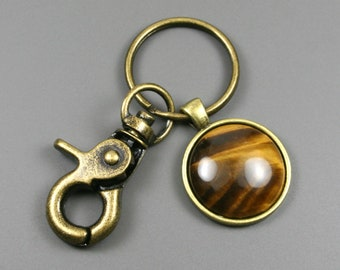 Tiger eye key chain in an antiqued brass setting with swivel lobster claw