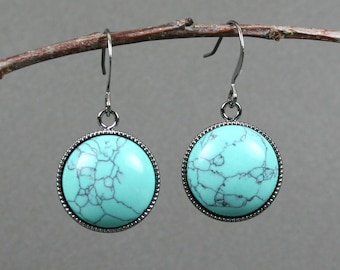 Turquoise howlite earrings in gunmetal plated bezels on gunmetal plated ear wires