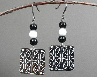 Celtic black and white earrings with obsidian, snow quartz, and a square charm with Celtic designs in black and white on gunmetal earwires