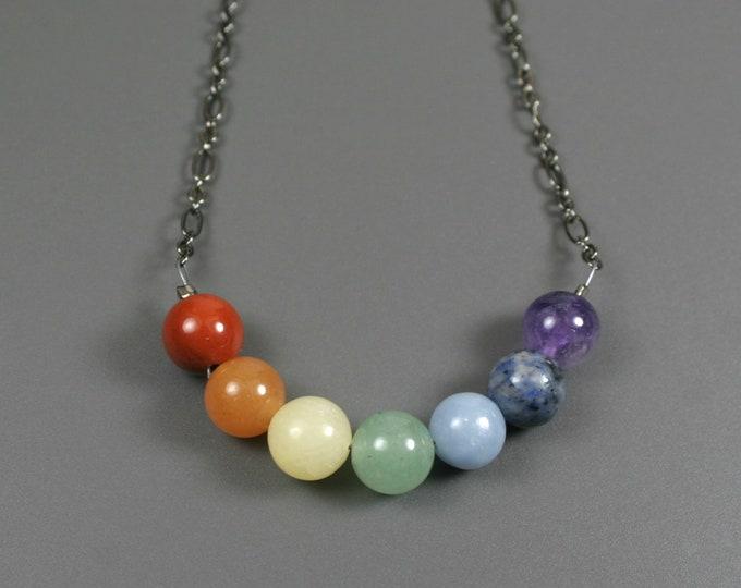 Rainbow stone bead necklace on gunmetal figaro chain