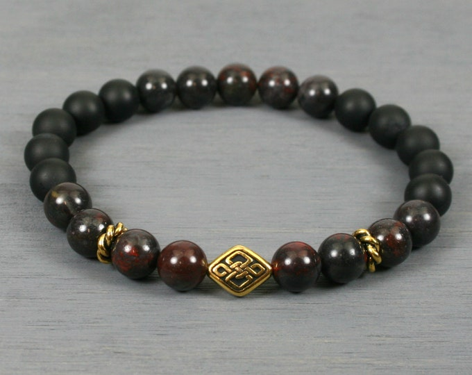 Mustang jasper and matte black onyx stretch bracelet with an antiqued gold plated Celtic knot focal bead
