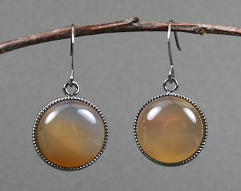 Orange red agate earrings in gunmetal plated bezels on gunmetal plated ear wires