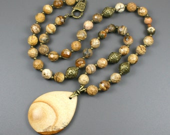 Picture jasper stone teardrop pendant on strand of picture jasper and antiqued brass