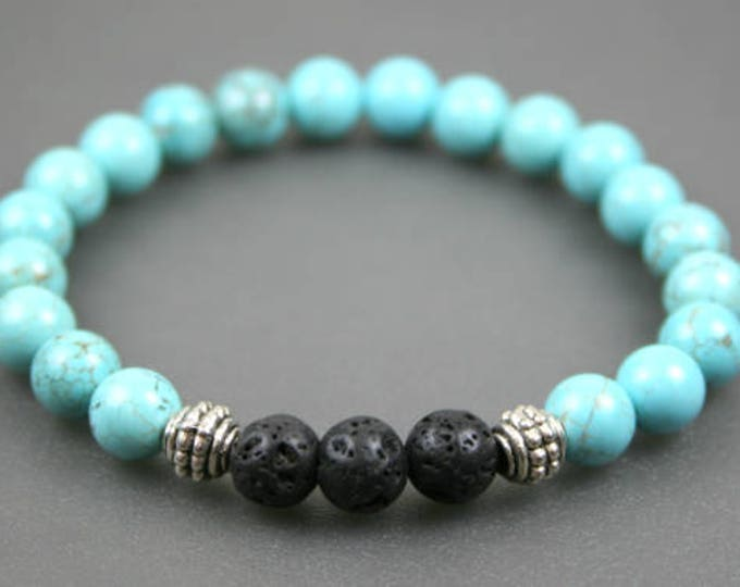 Turquoise magnesite, black lava rock, and silver plated roundel stacking stretch bracelet