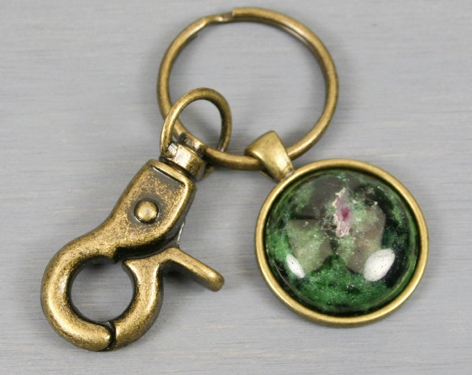 Ruby in zoisite key chain in an antiqued brass setting with swivel lobster claw