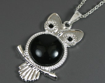 Black onyx stone pendant in silver plated owl bezel setting on chain, owl pendant