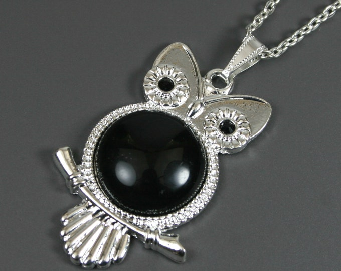 Black onyx stone pendant in silver plated owl bezel setting on chain