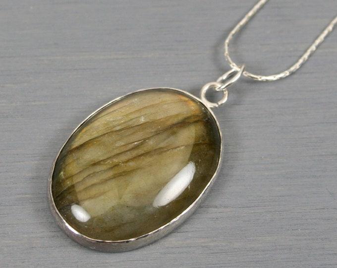 Labradorite pendant set in a sterling silver bezel on sterling silver chain
