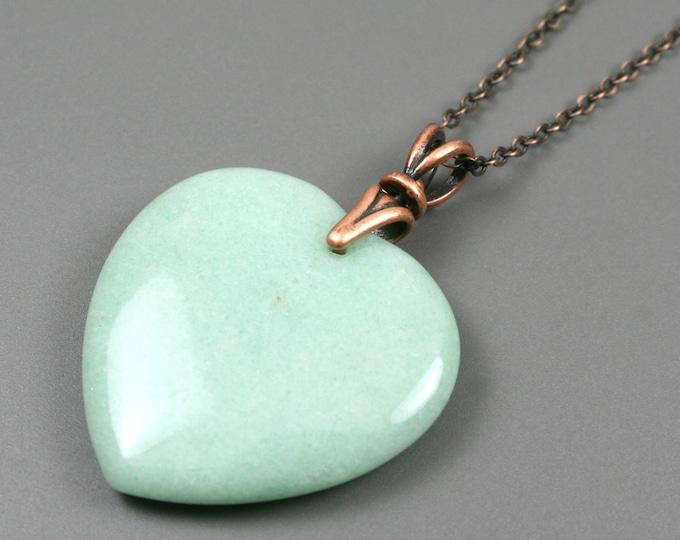 Green aventurine heart pendant on antiqued copper chain