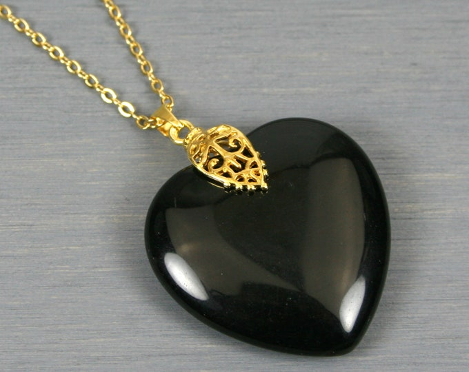 Obsidian heart pendant with filigree bail on gold plated cable chain