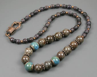 Brown snowflake jasper and turquoise ceramic necklace with dark brown wood, black bone, and antiqued copper accents