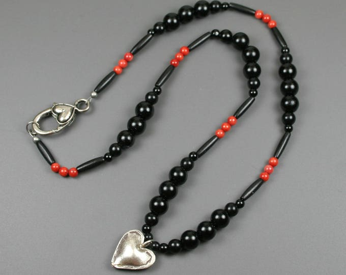 Hill Tribes fine silver puffed heart pendant on strand of obsidian, black bone, and bamboo coral