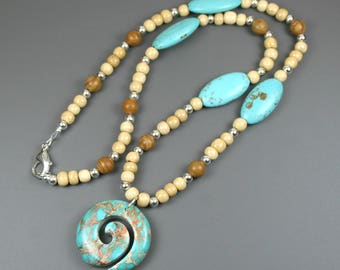 Turquoise magnesite stone spiral pendant on beaded strand of antiqued bone, tiger jasper, turquoise magnesite, and silver