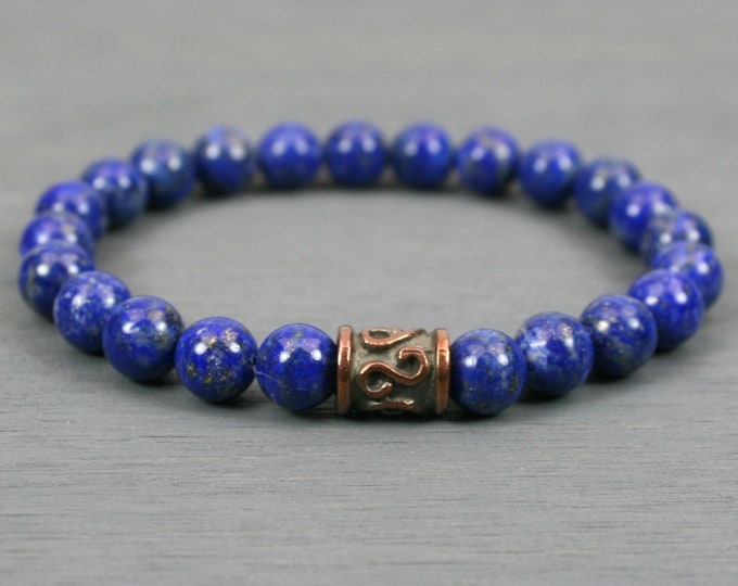 Lapis lazuli stacking stretch bracelet with a Greek bronze plated spiral key barrel focal bead