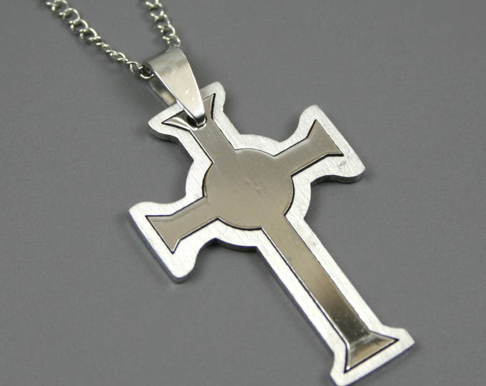 Stainless steel cross pendant on stainless steel chain