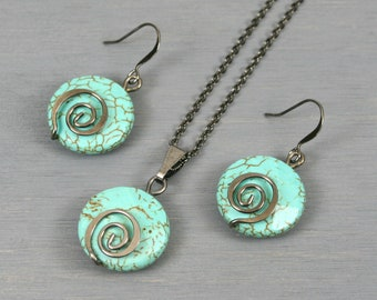 Turquoise magnesite and gunmetal plated spiral necklace and earring set