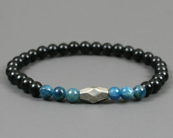 Blue apatite and obsidian stacking stretch bracelet with an antiqued silver plated focal bead