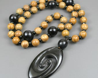 Tiger jasper gratitude beads with buri root, black glass, and horn double spiral opening focal on cord