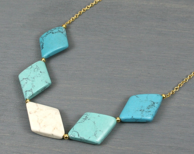 Ombre turquoise to white magnesite skewed diamond necklace on gold plated cable chain