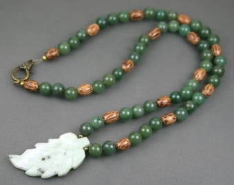 Light green marble leaf pendant on strand of green aventurine, wood, and antiqued brass