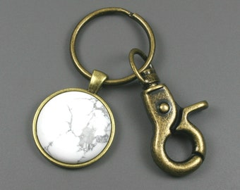 White howlite key chain in an antiqued brass setting with swivel lobster claw