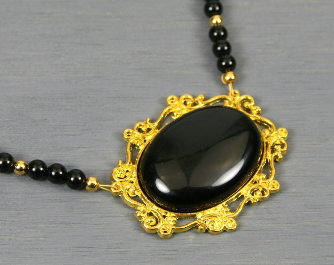 Black onyx pendant in gold plated setting on a black onyx beaded necklace
