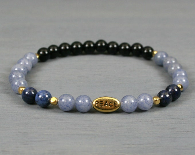 Blue aventurine, dumortierite, and obsidian stacking stretch bracelet with a gold plated PEACE bead and gold plated spacer beads