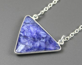 Sapphire pendant with silver plated edging on silver plated cable chain