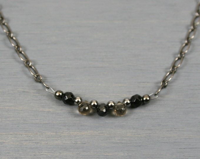 Black spinel and smoky quartz briolette necklace with black agate and gunmetal accents on gunmetal plated chain