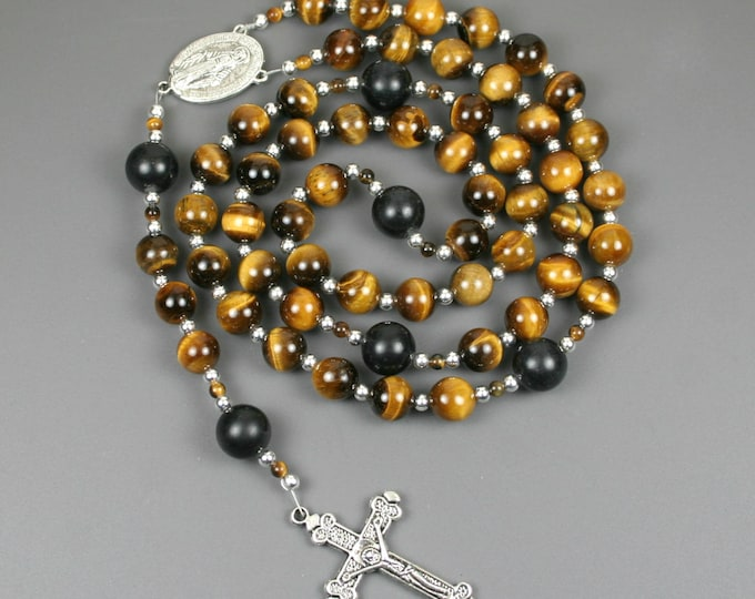 Tiger eye, obsidian, and silver rosary in the Roman Catholic style