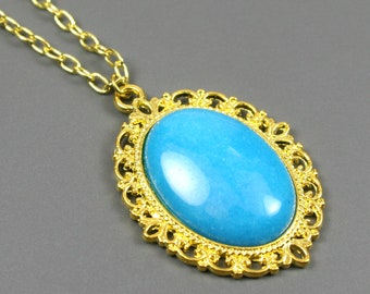 Blue dolomite pendant in gold plated setting on brass chain necklace