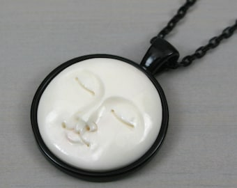 Moon face bone cabochon pendant in black bezel setting on black chain, moon pendant, bone pendant, moon jewelry, bone jewelry