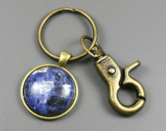 Sodalite key chain in an antiqued brass setting with swivel lobster claw