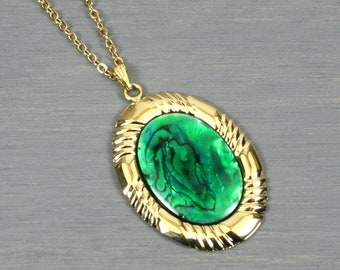 Green paua shell pendant set in a gold plated setting on gold plated cable chain