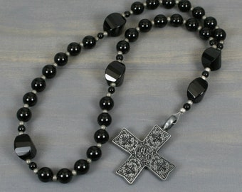 Anglican rosary in obsidian and black onyx with an antiqued pewter cross with Celtic design