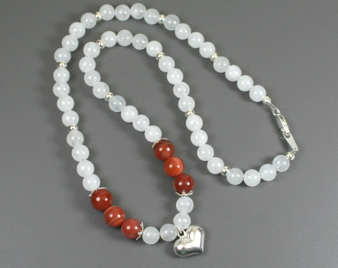 Sterling silver puffed heart pendant on strand of snow quartz and banded red agate