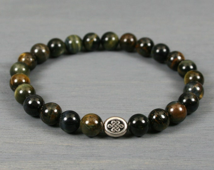 Blue tiger eye stacking stretch bracelet with an antiqued silver plated Celtic knot bead
