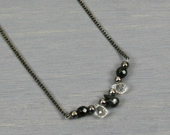 Black spinel and crystal quartz briolette necklace with black agate and gunmetal accents on gunmetal plated chain