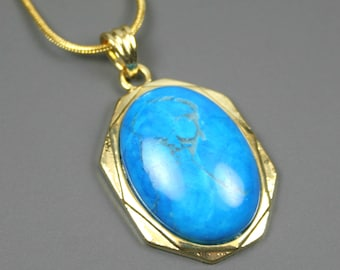 Turquoise howlite pendant set in an antiqued gold plated setting on gold plated snake chain